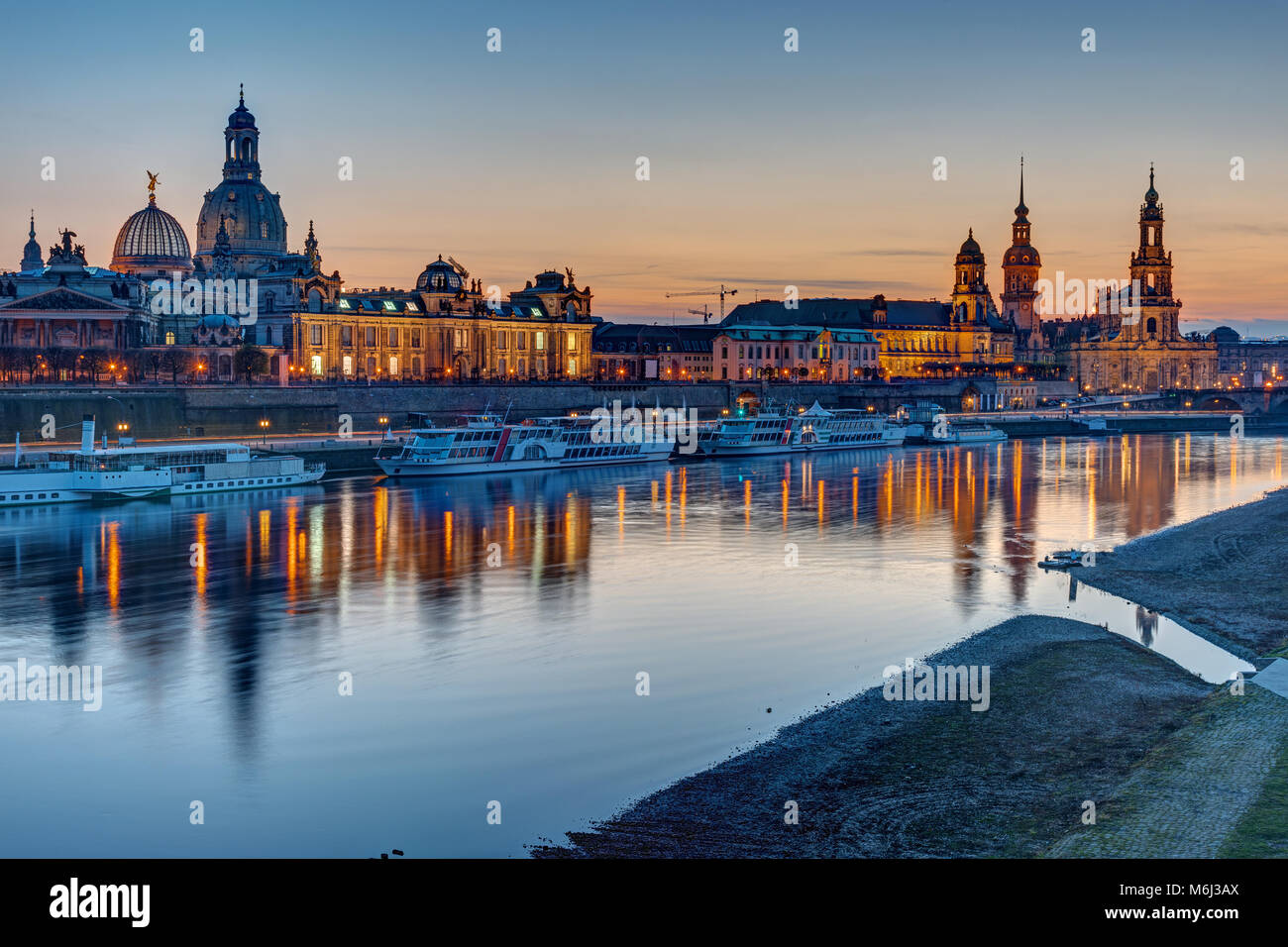 The old town of Dresden with the river Elbe after sunset - Stock Image