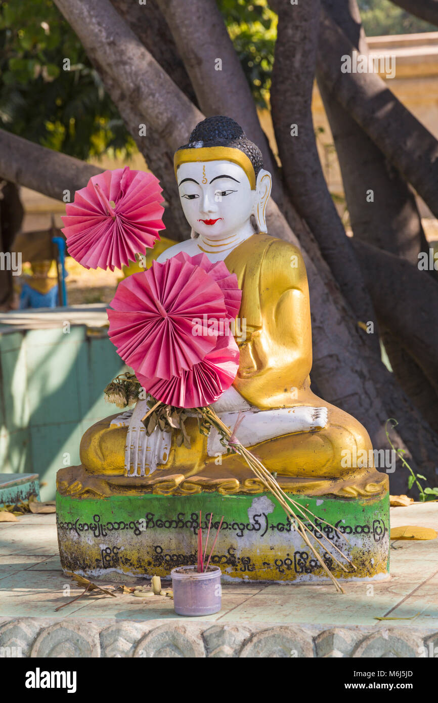Buddha statue in the grounds of Ananda Pagoda, Ananda Temple at Bagan, Myanmar (Burma), Asia in February Stock Photo