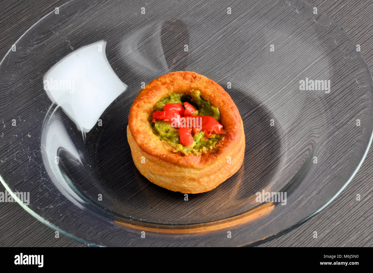 Vol-au-vent with mushroom and chicken, in a glass plate Stock Photo