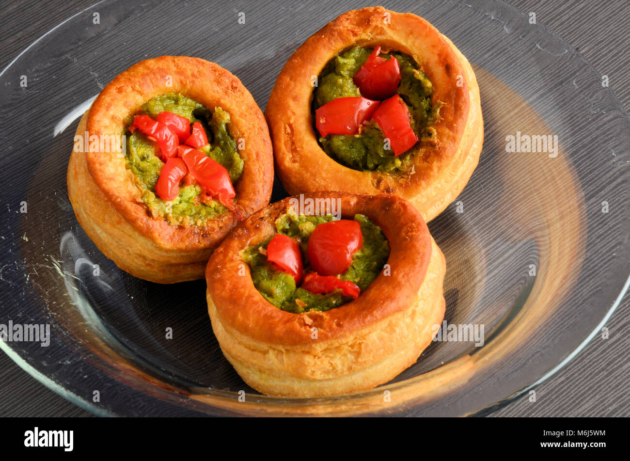 Vol-au-vent with mushroom and chicken, in a glass plate - Stock Image