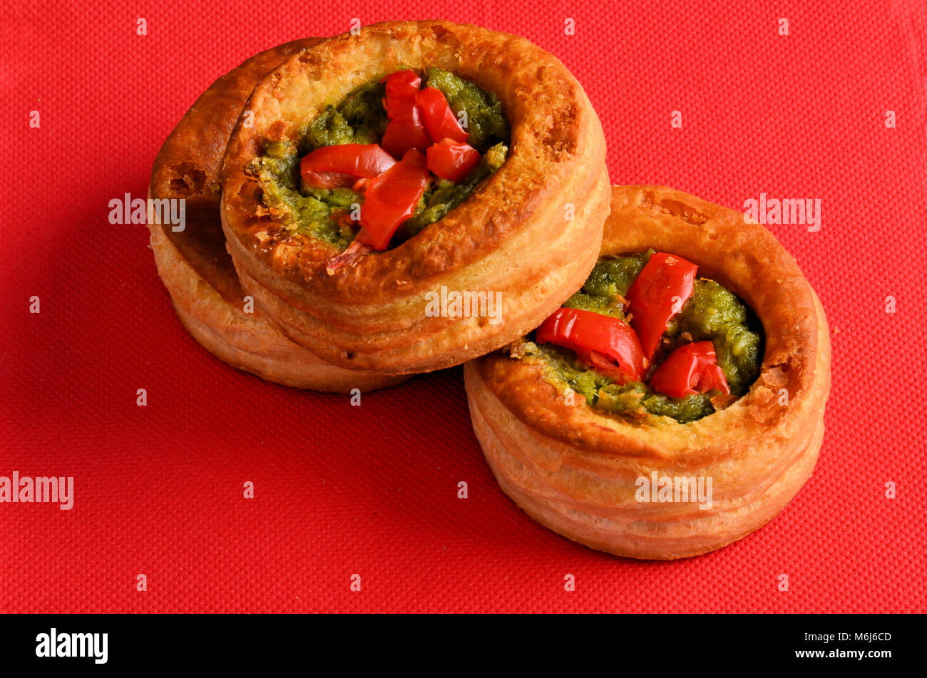 Vol-au-vent with mushroom and chicken, on a red paper - Stock Image
