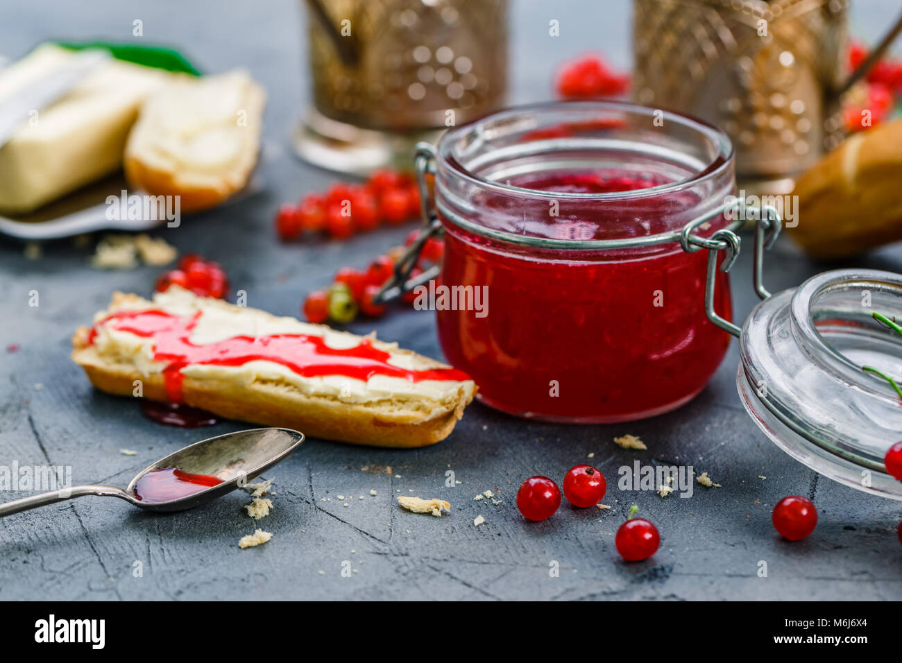 Red currants jam and berries, close view - Stock Image