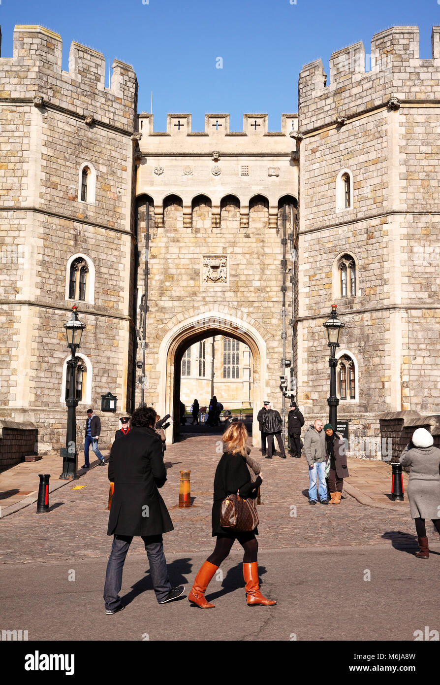 The Entrance to Windsor Castle in England with sightseers walking by - Stock Image