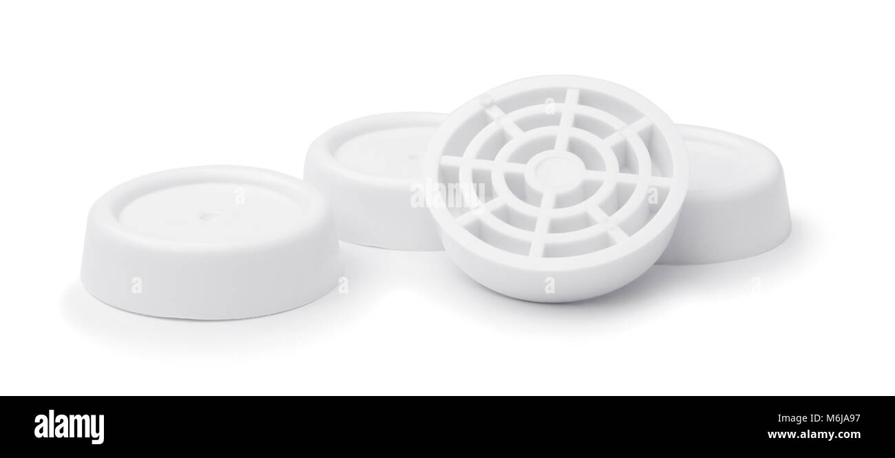 Anti-vibration pads for washing machine isolated on white Stock Photo