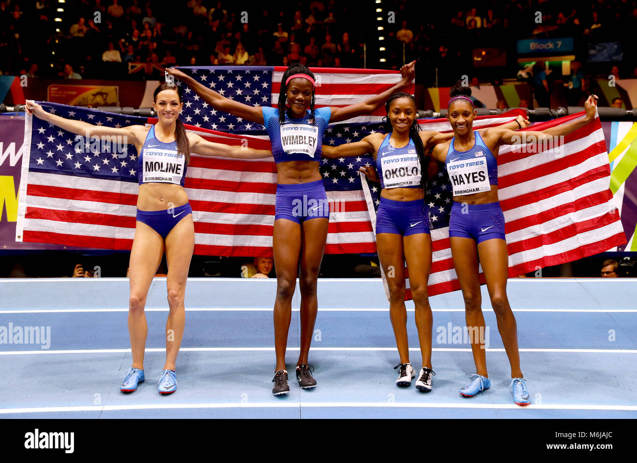 (From left to right) USA's Georganne Moline, Shakima Wimbley, Courtney Okolo and Quanera Hayes celebrate winning - Stock Image
