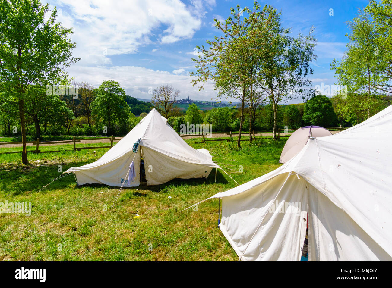 white tents in a scout camp - Stock Image