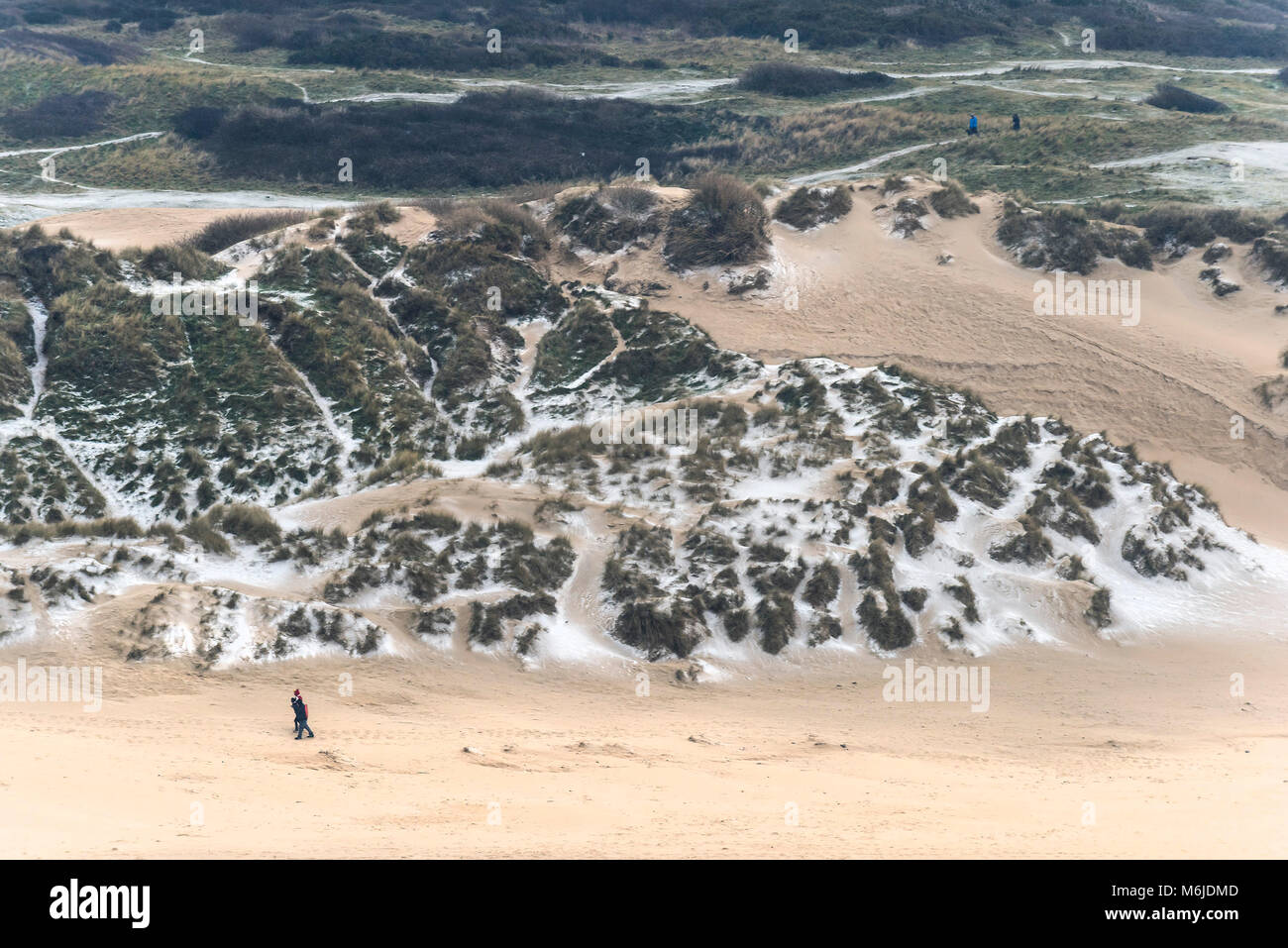 UK weather Snow settling on sand dunes at Crantock Beach in Newquay Cornwall. - Stock Image