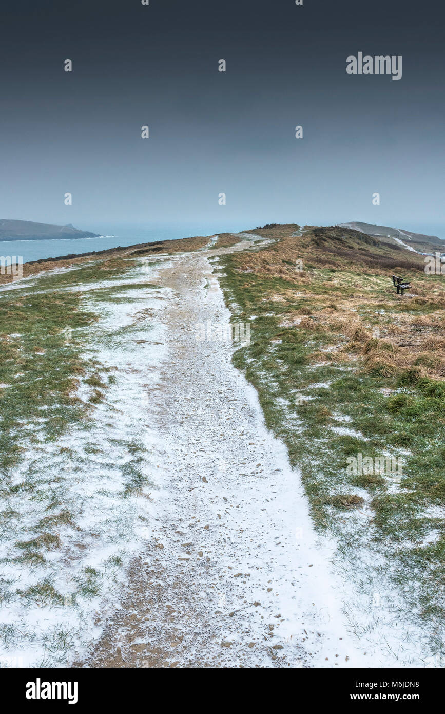 A path dusted with snow on East Pentire in Newquay Cornwall. - Stock Image