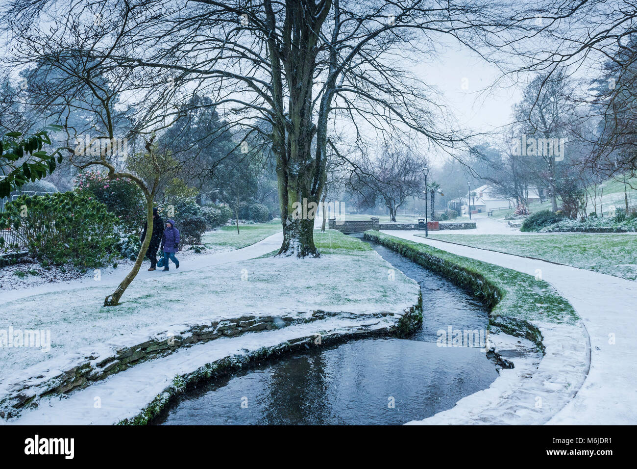 A winter snow scene in Trenance Gardens in Newquay Cornwall. - Stock Image