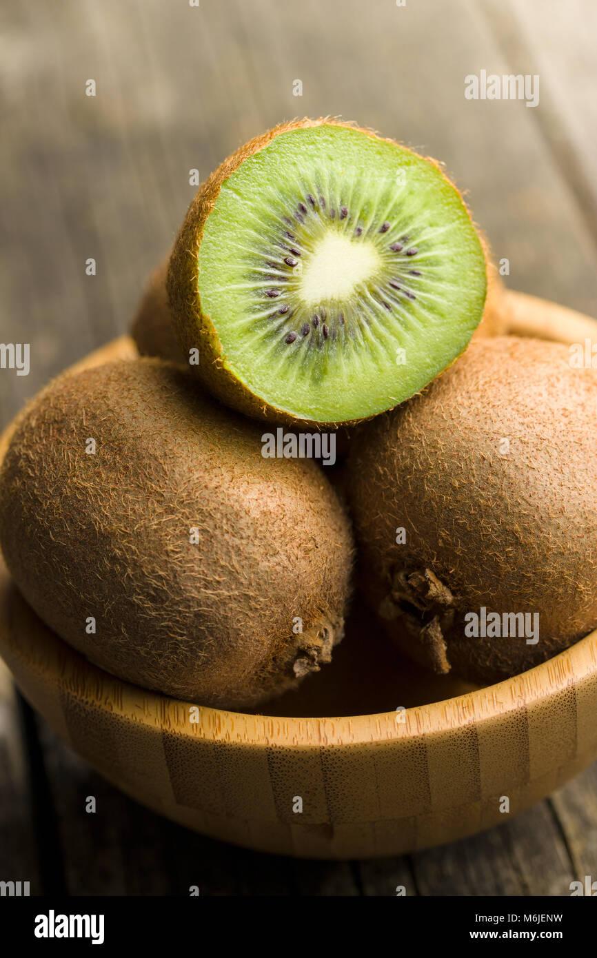 Halved kiwi fruit in bowl. - Stock Image