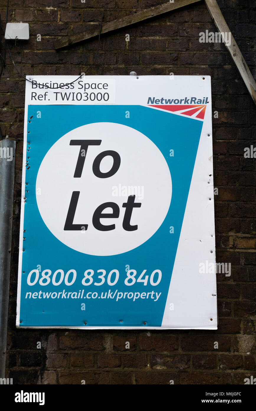 A Network rail sign / signage advertising property to let under some railway arches. (95) - Stock Image