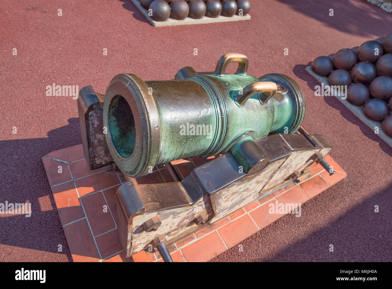 An ancient fortress cannon with cores near the princely palace in Monaco. - Stock Image