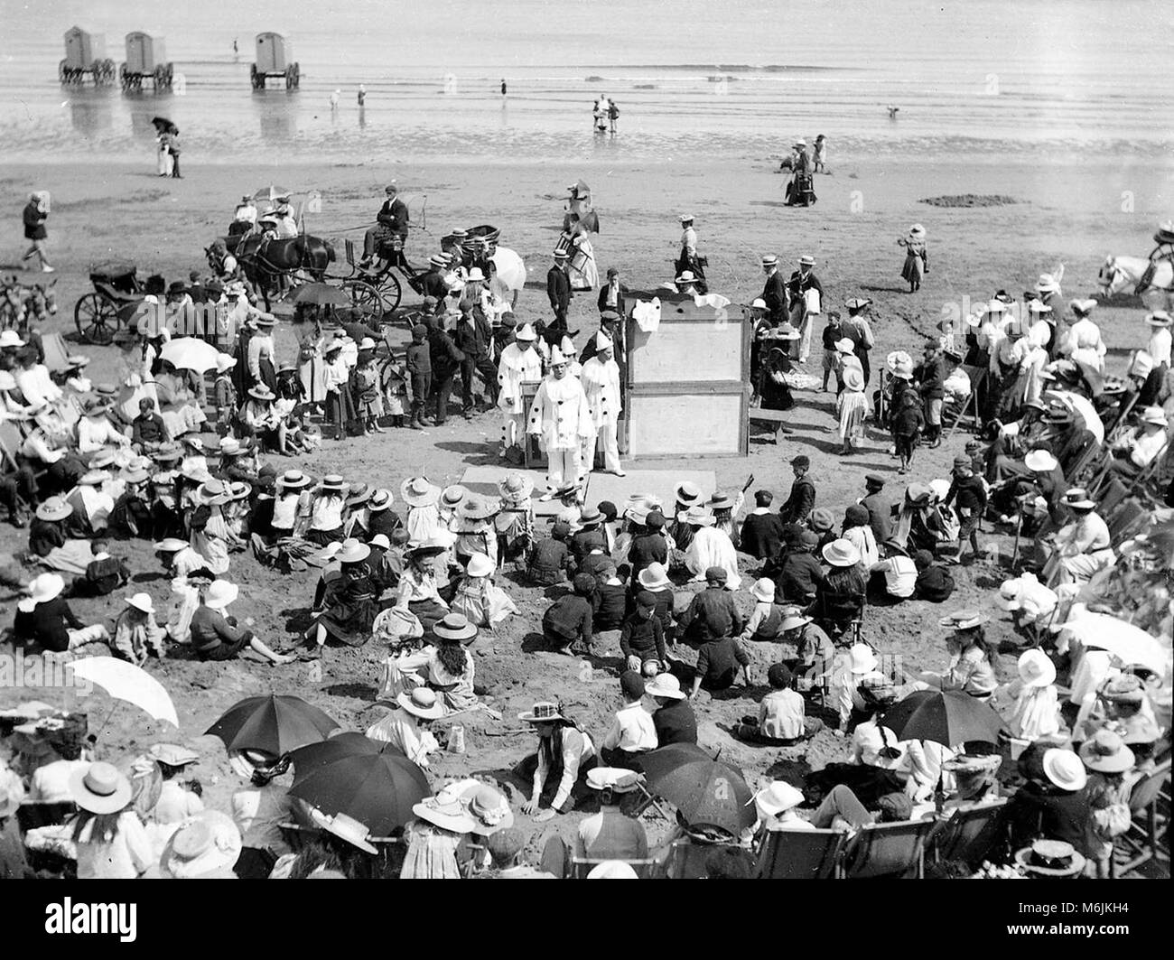 Filey seaside beach crowd watching Pierrots Entertainers in North Yorkshire in 1899 - Stock Image