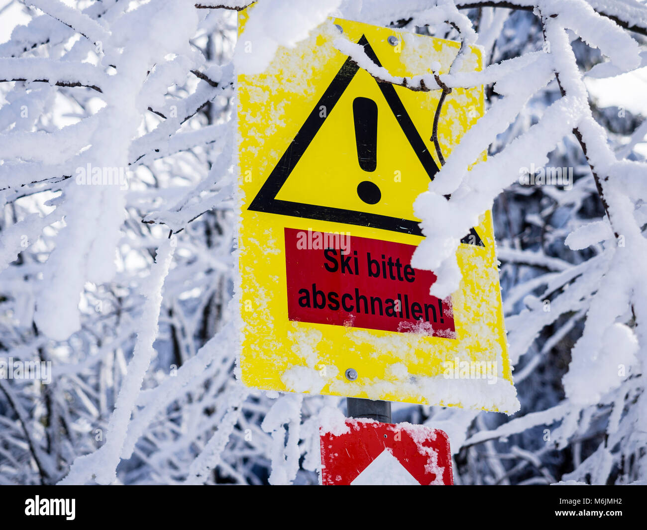 Warning sign on loipe, steep hill,  take off skis, Harz, Lower-Saxony, Germany Stock Photo