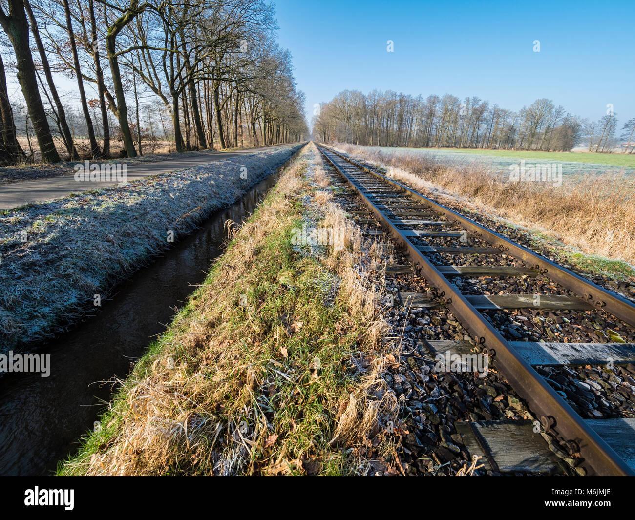 Railroad tracks of the OHE,  Osthannoversche Eisenbahnen, winter day, rural road, railway network, Lachtehausen, Stock Photo