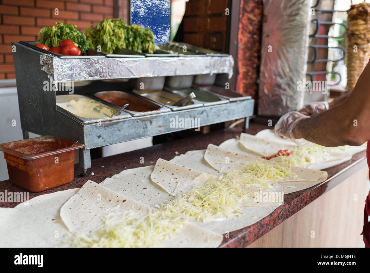 Cooking process of shawarma, traditional turkish meat, workflow closeup, set - Stock Image
