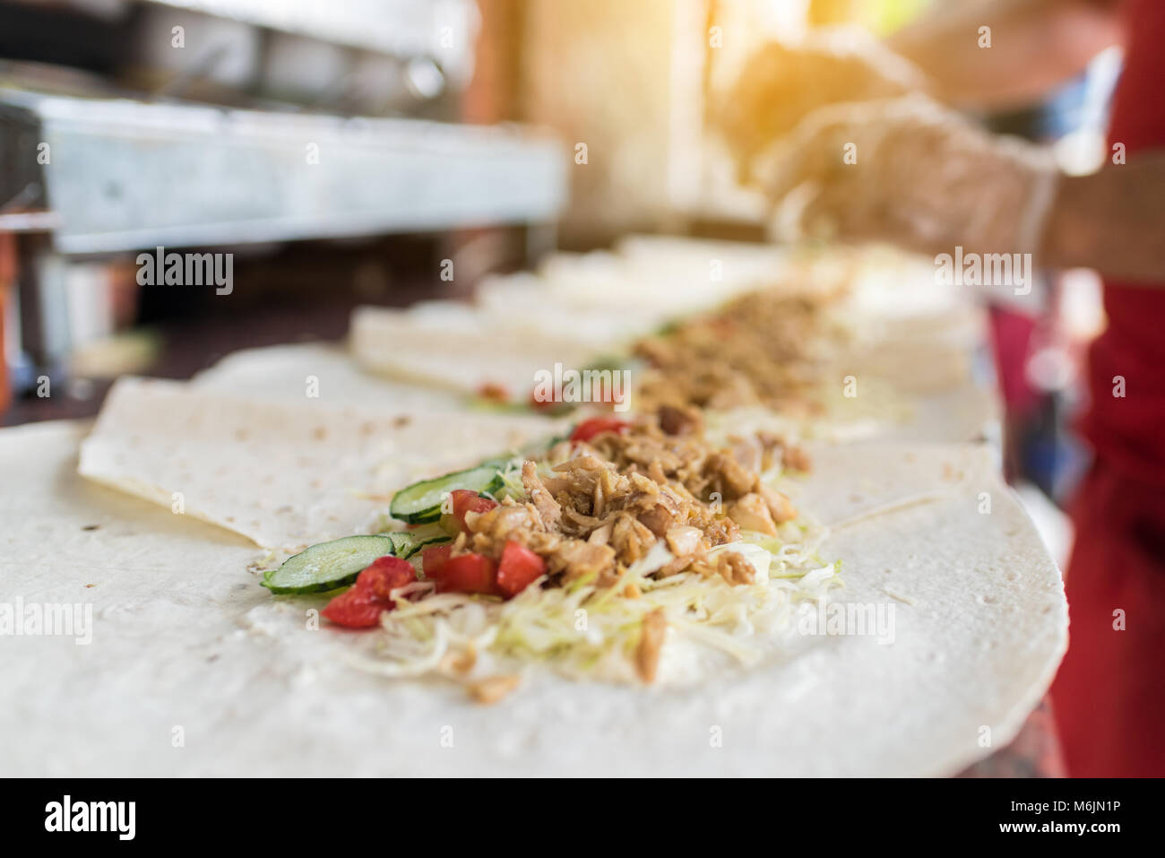 Cooking process of shawarma, traditional turkish meat, workflow closeup, set - Stock Image