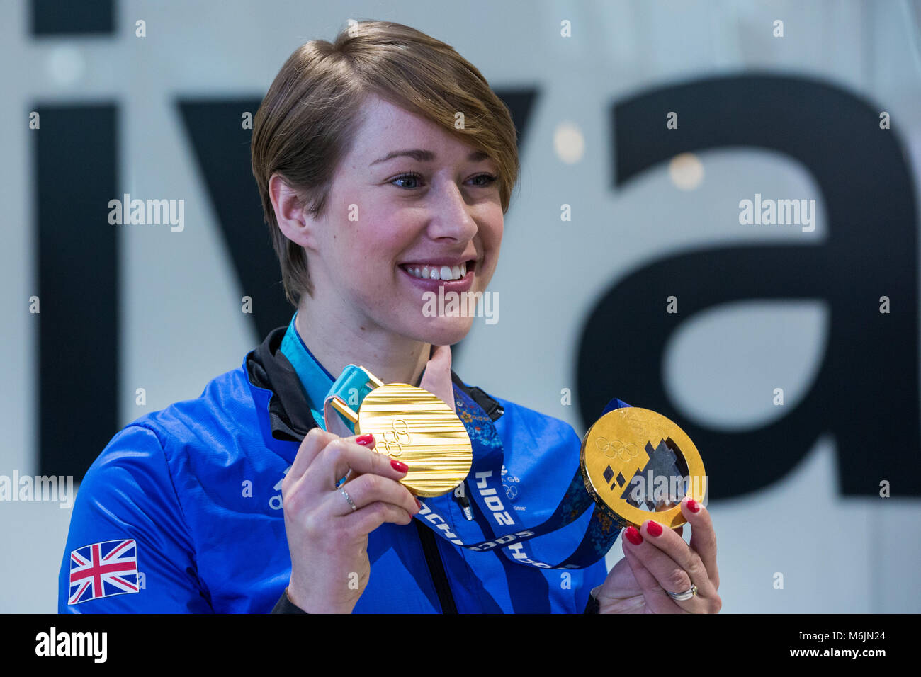 London, UK. 26th February, 2018. Lizzy Yarnold displays the women's skeleton gold medals which she won at Pyeongchang - Stock Image