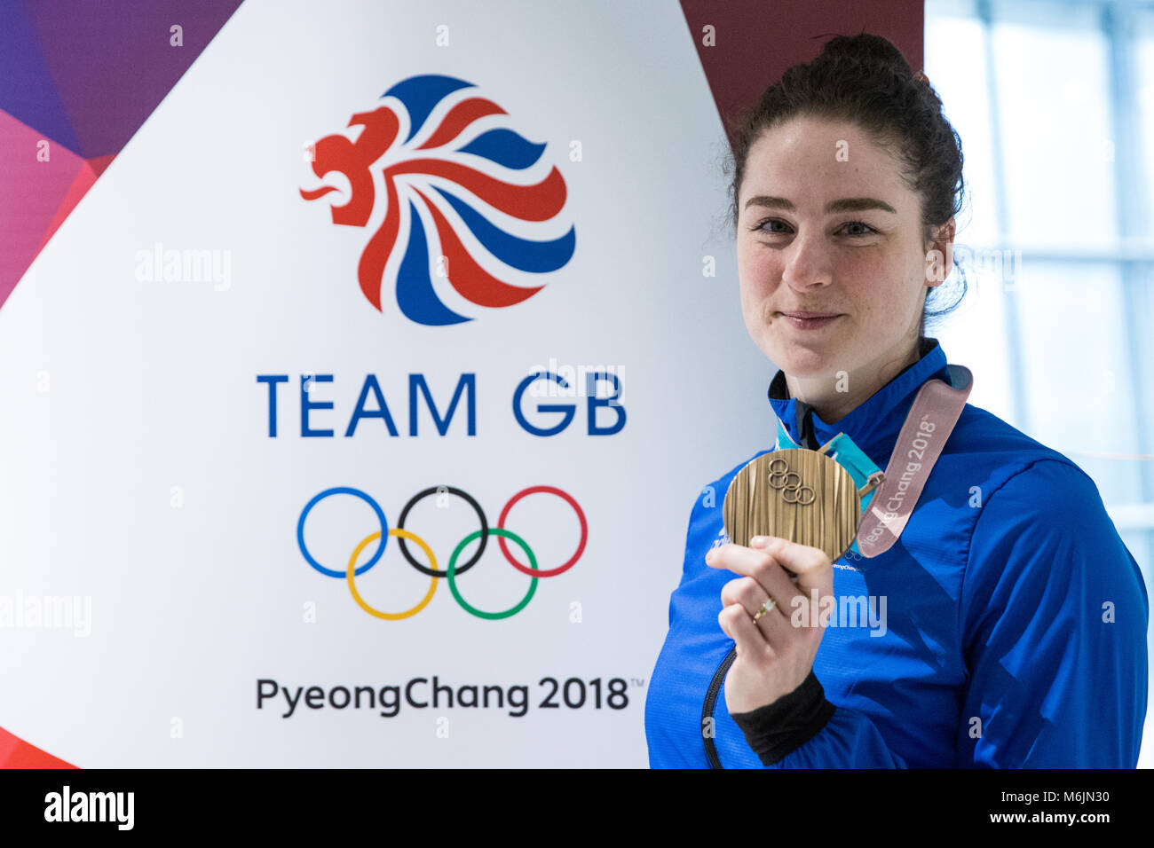 London, UK. 26th February, 2018. Laura Deas displays her women's skeleton bronze medal as the British Olympic - Stock Image