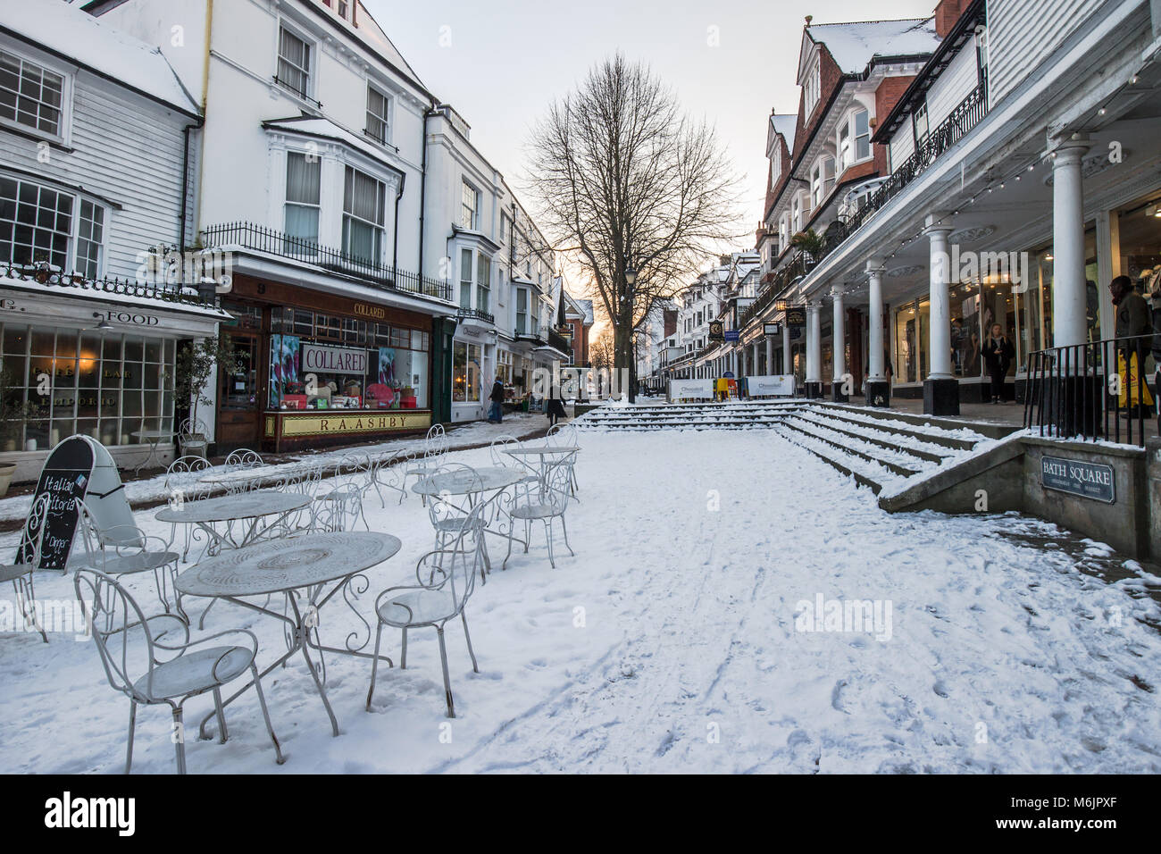 Tunbridge Wells Pantiles in winter 2018 with Beast from the East snow at sunset dusk with golden light - Stock Image
