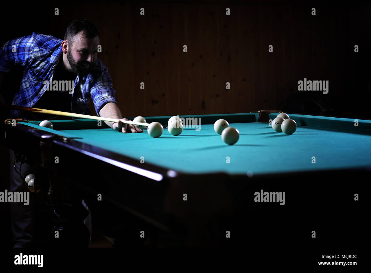 A Man With A Beard Plays A Big Billiard. Party In A 12 Foot Pool
