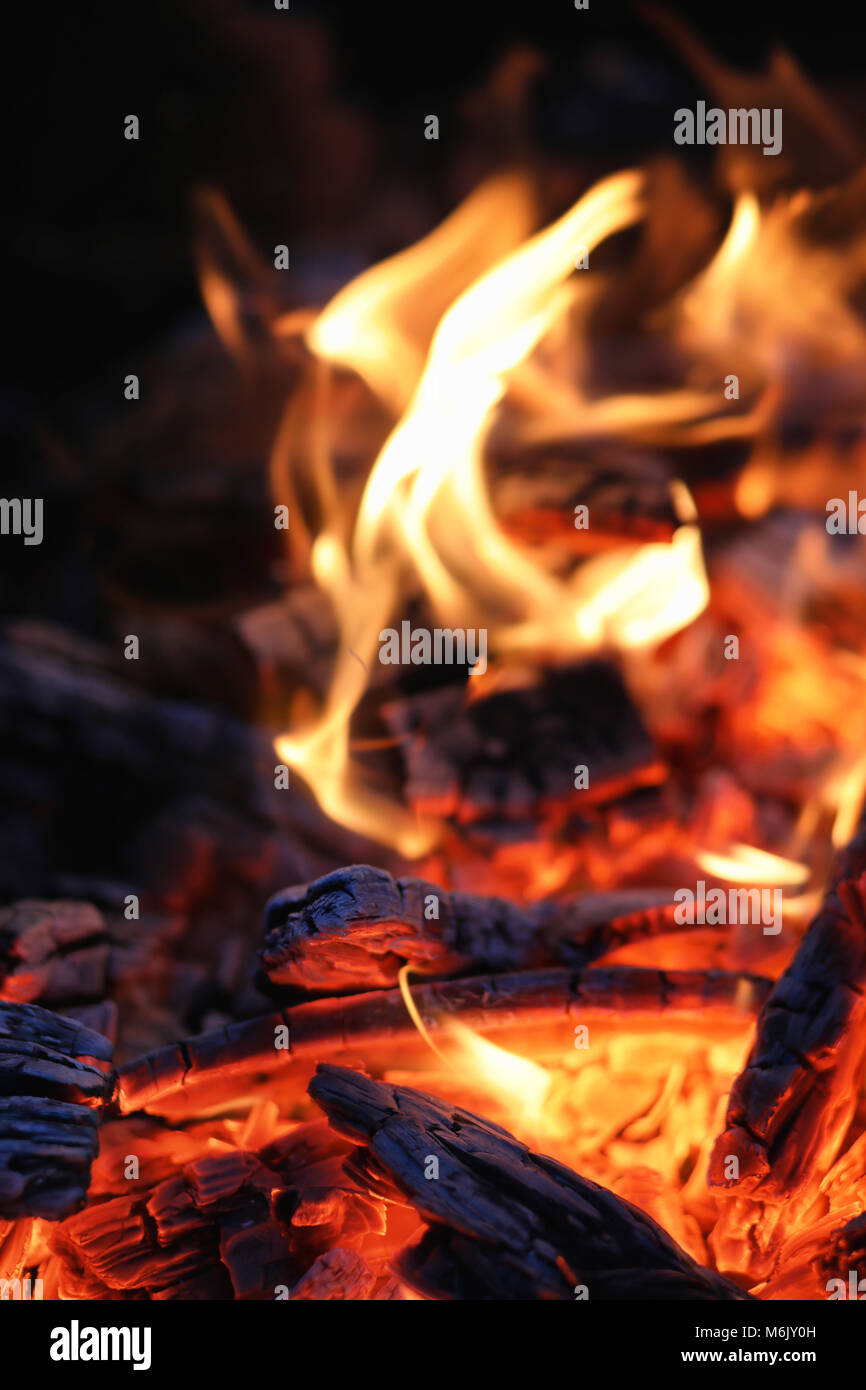 Smoldering ashes of a bonfire. - Stock Image