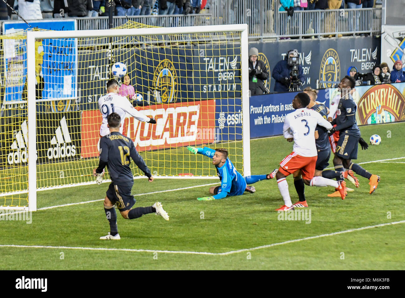 Soccer - football players jumping and leaping to head the ball during a Gabriel Somi of Sweden saves a curing corner - Stock Image