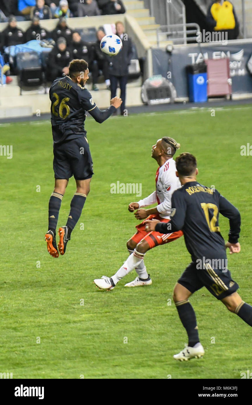 Soccer - football players jumping and leaping to head the ball during a Professional football - soccer match at - Stock Image