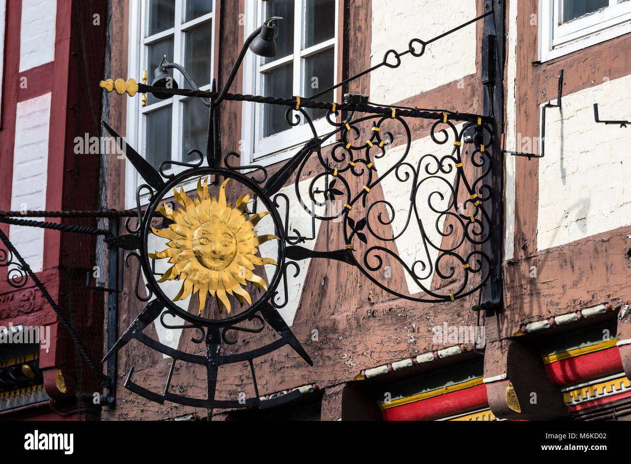 metal shop sign, historical center of Celle, half-timbered house in street 'Schuhstrasse', Celle, Lower Saxony, Stock Photo