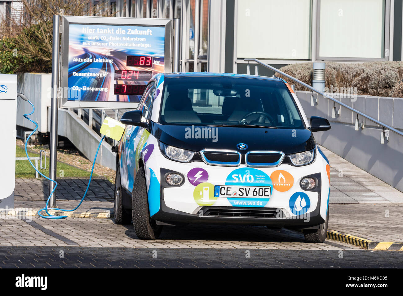 Electric car gets charged at local power supply company, using renewable solar energy, Celle, Germany, Lower-Saxony Stock Photo