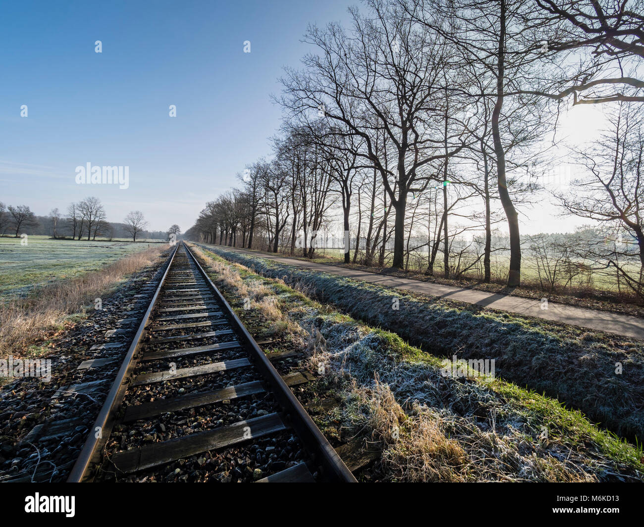 Railroad tracks of the OHE,  Osthannoversche Eisenbahnen, winter day, rural road, railway network, Lachtehausen, Stock Photo