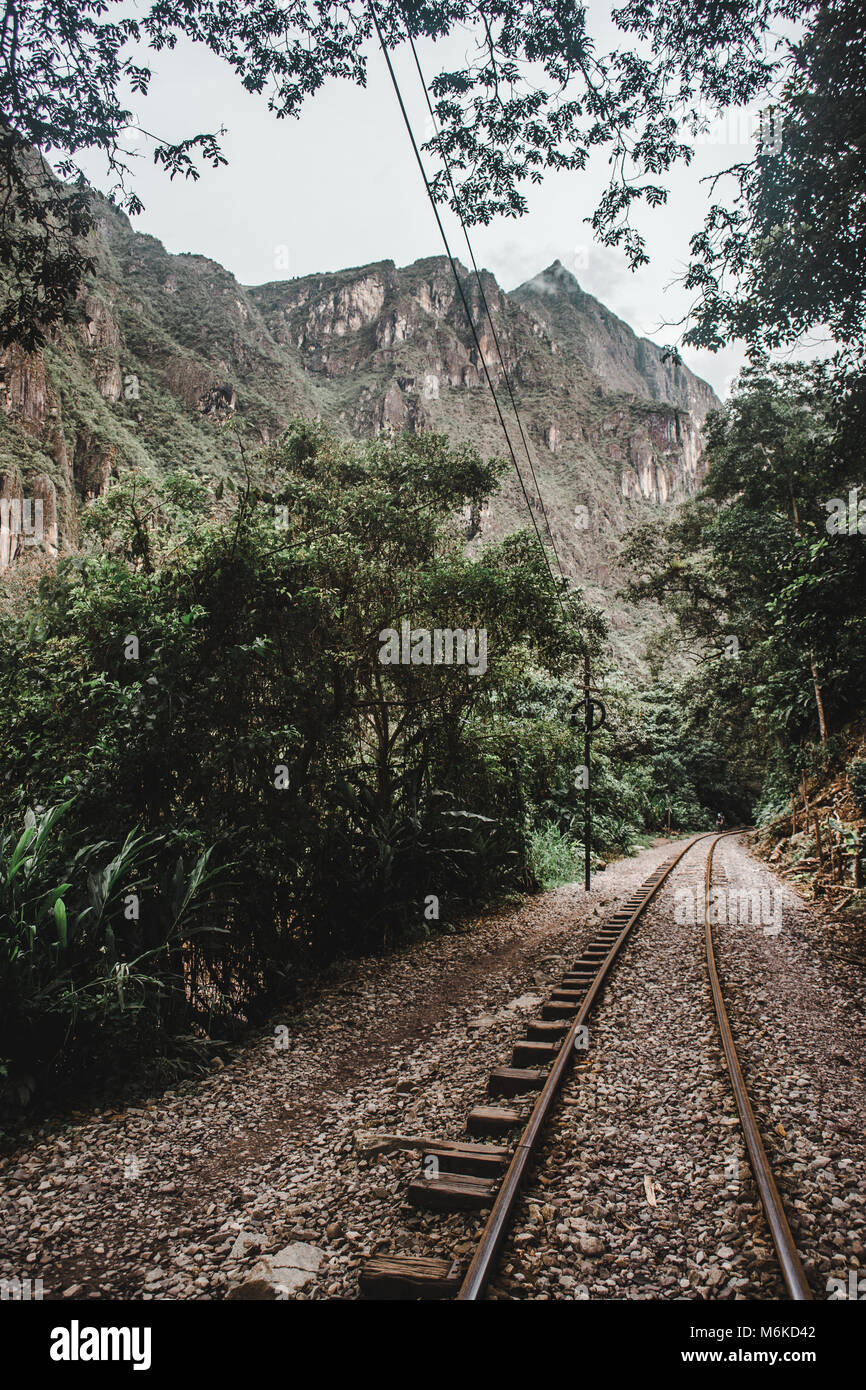 Old railways tracks running alongside the Urubamba River, a popular route for those walking to Machu Picchu Stock Photo