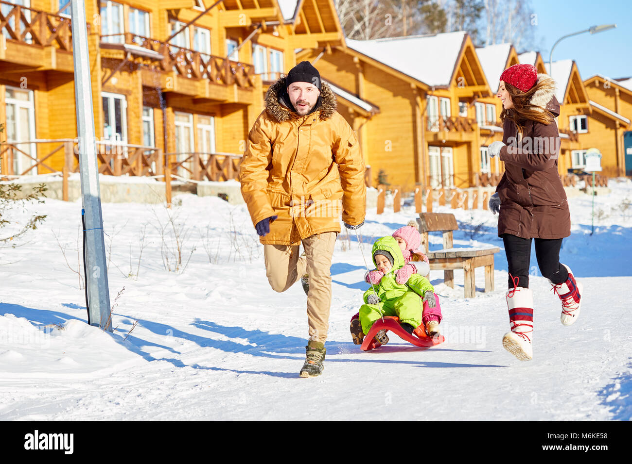 Family having fun in winter - Stock Image