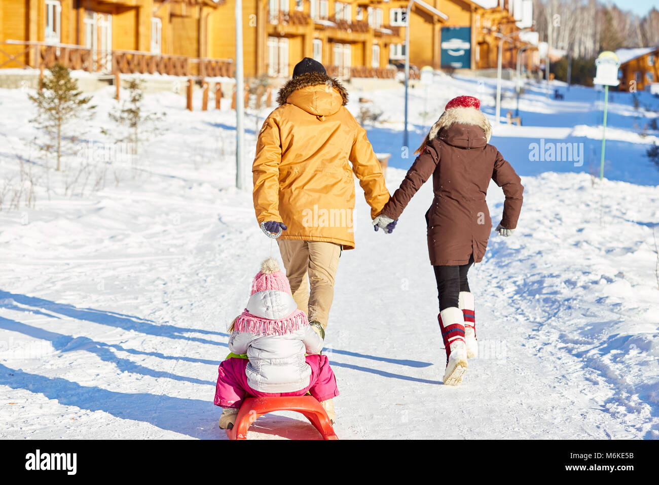 Active family on winter weekend - Stock Image