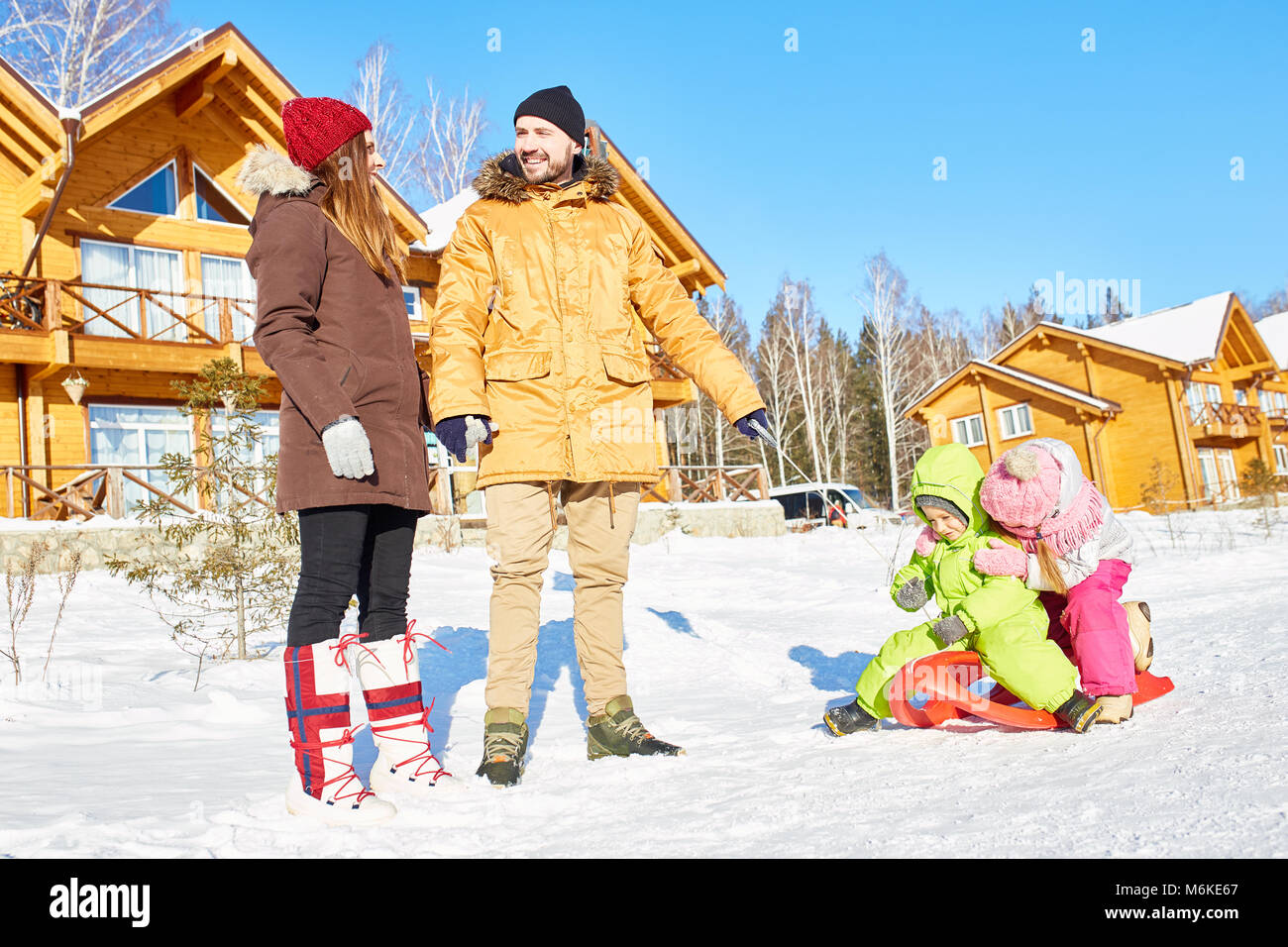 Active family on winter holidays - Stock Image
