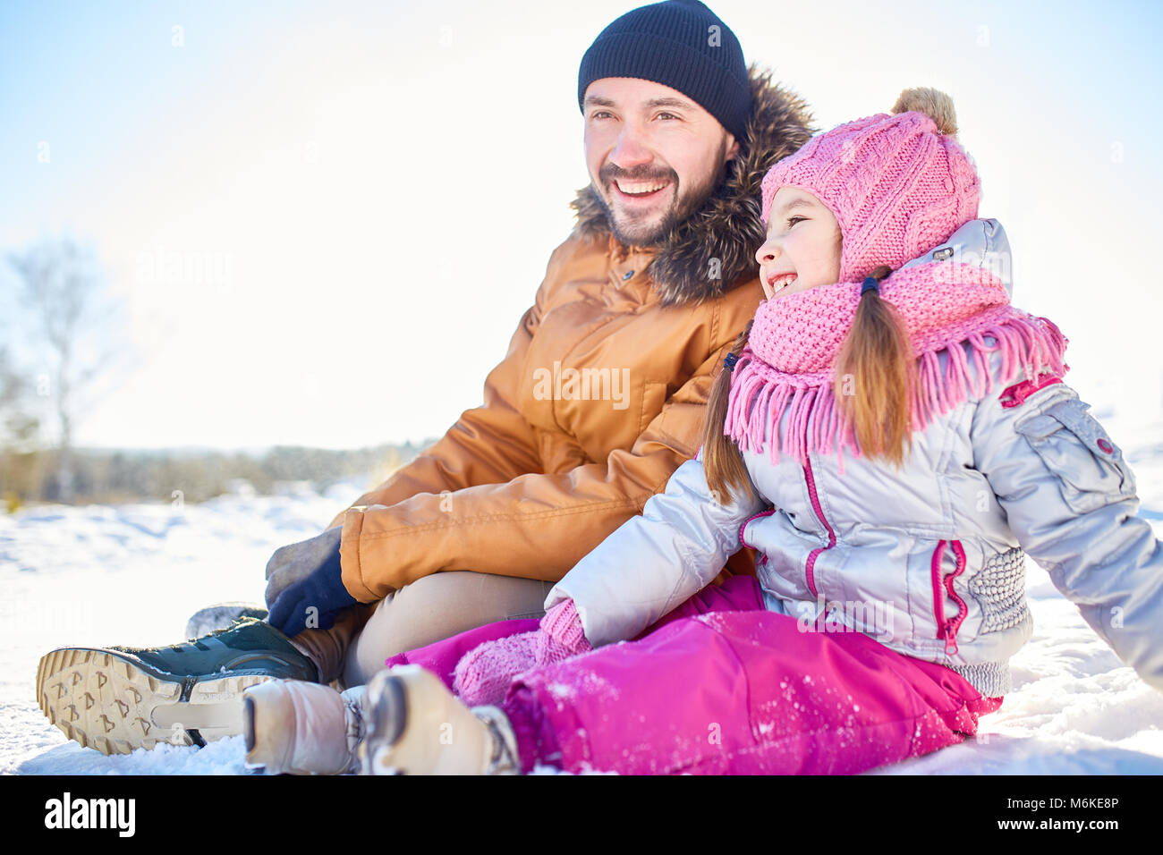 Cheerful girl on walk with dad - Stock Image