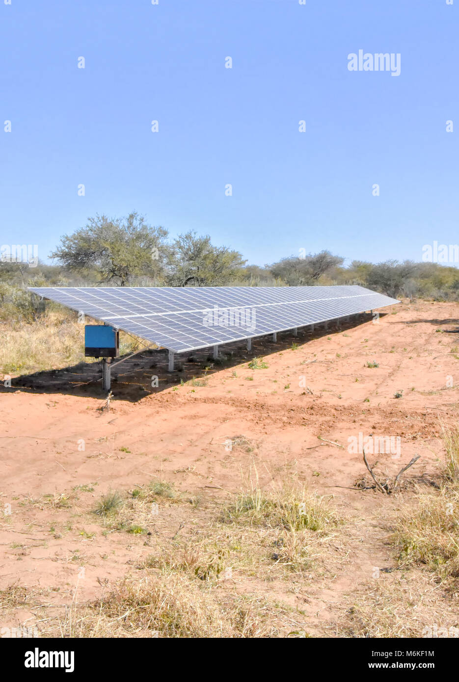 A large array of solar panels in Namibia placed in a wildlife refuge to power fences and accommodation - Stock Image