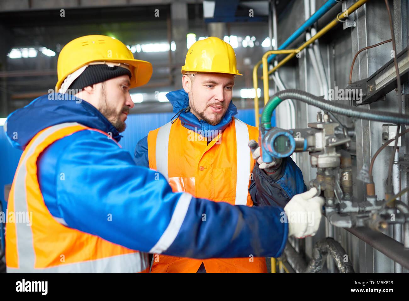Team Adjusting Equipment - Stock Image