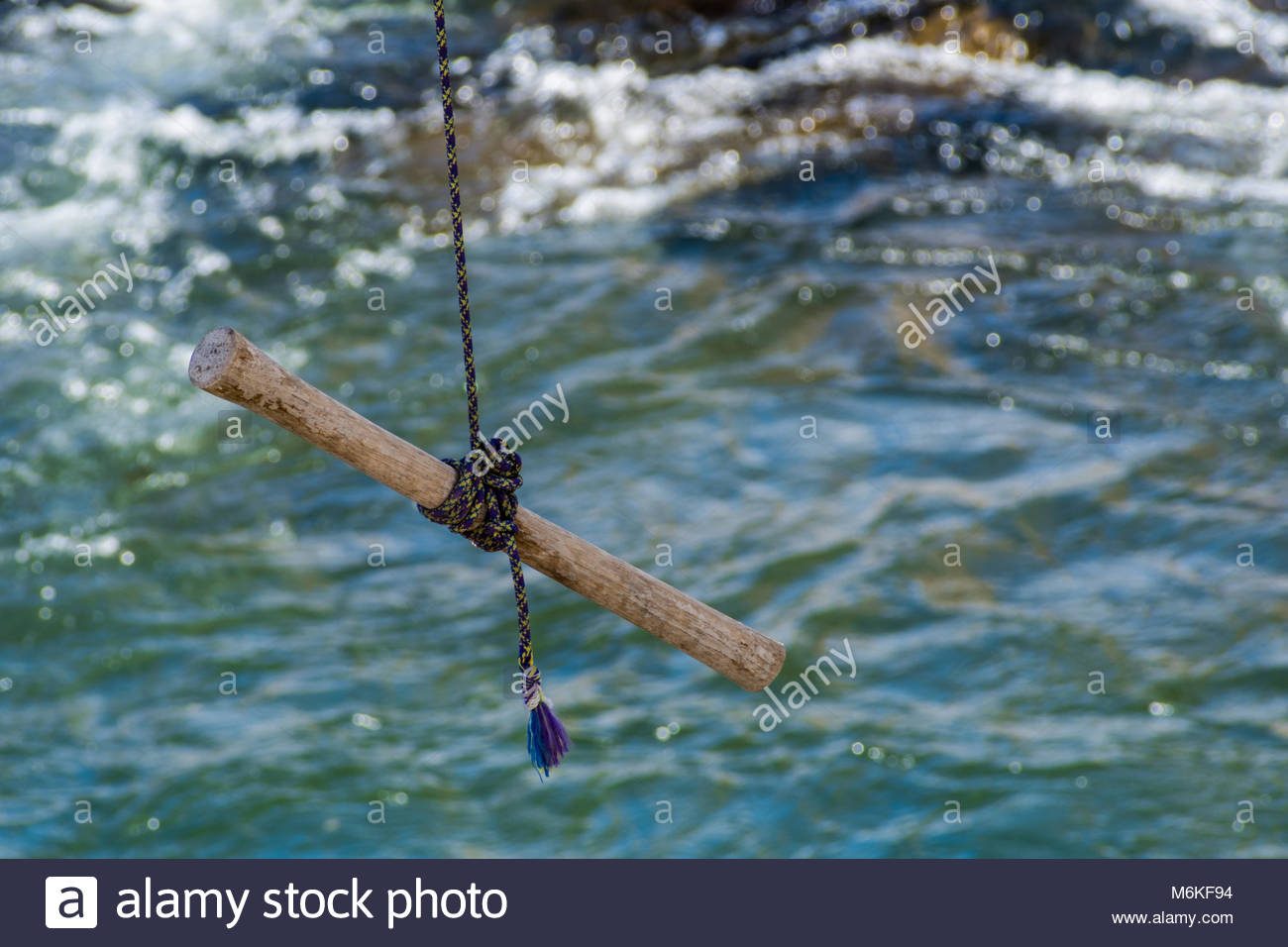 A rope swing dangles over the Truckee River. - Stock Image
