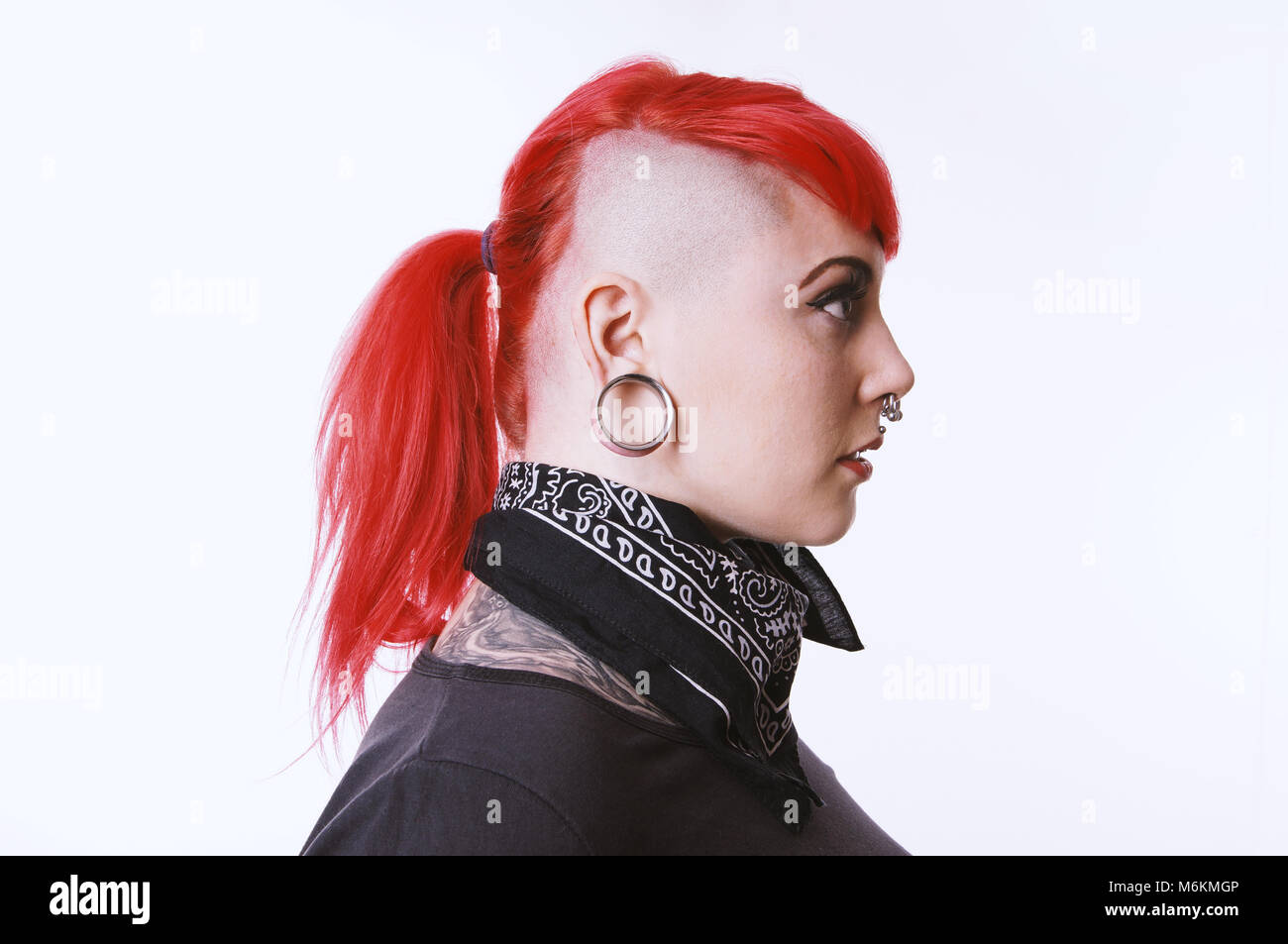 girl with sidecut piercings and tattoos Stock Photo