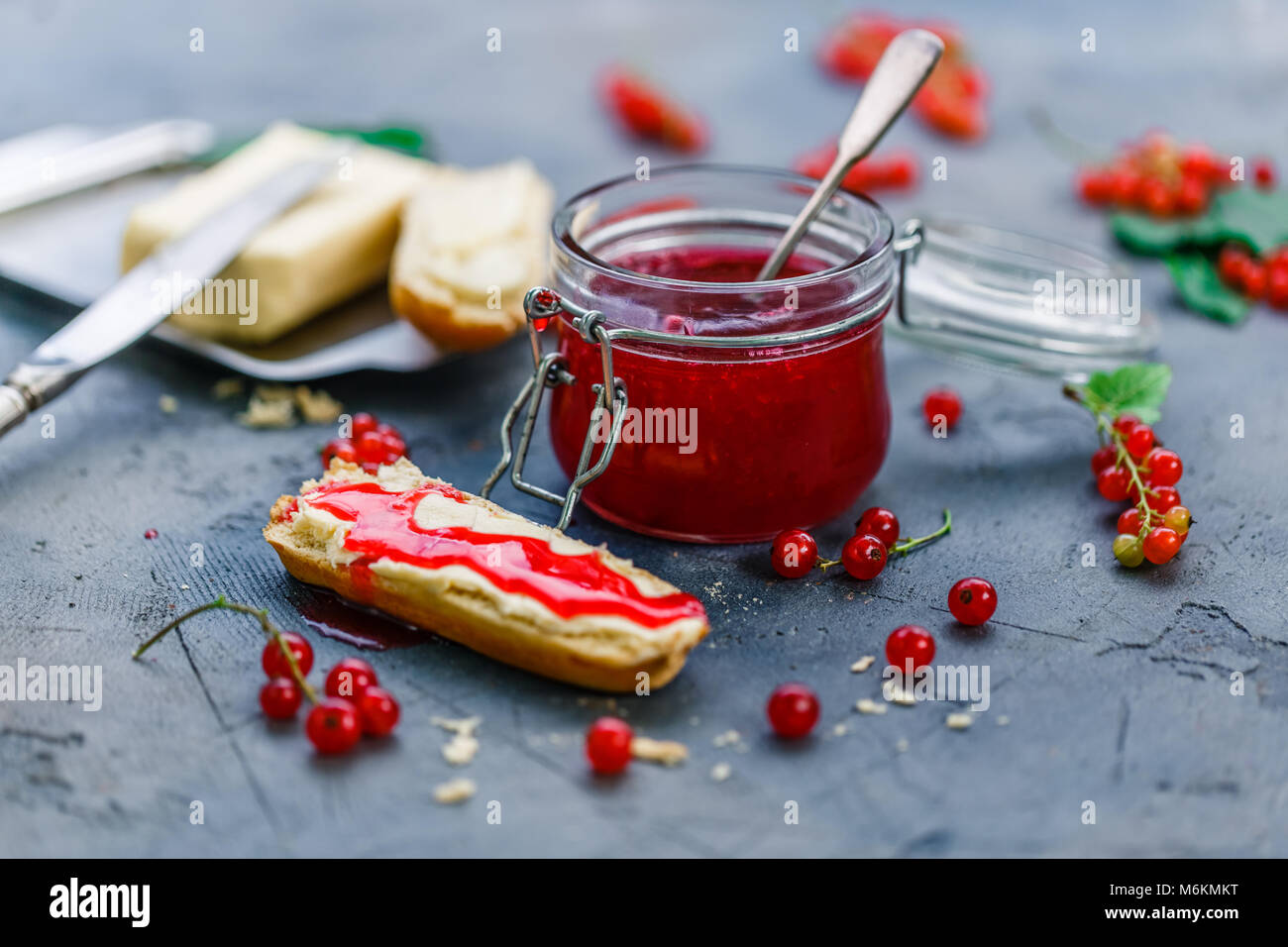 Tasty red currants jamwith brioche and butter. - Stock Image