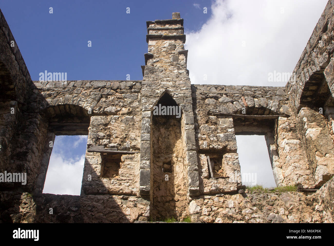 old stone fireplace. Looking at the sky through interior of a ruined old stone house  Stock Image Old Stone Fireplace Window Inside Photos