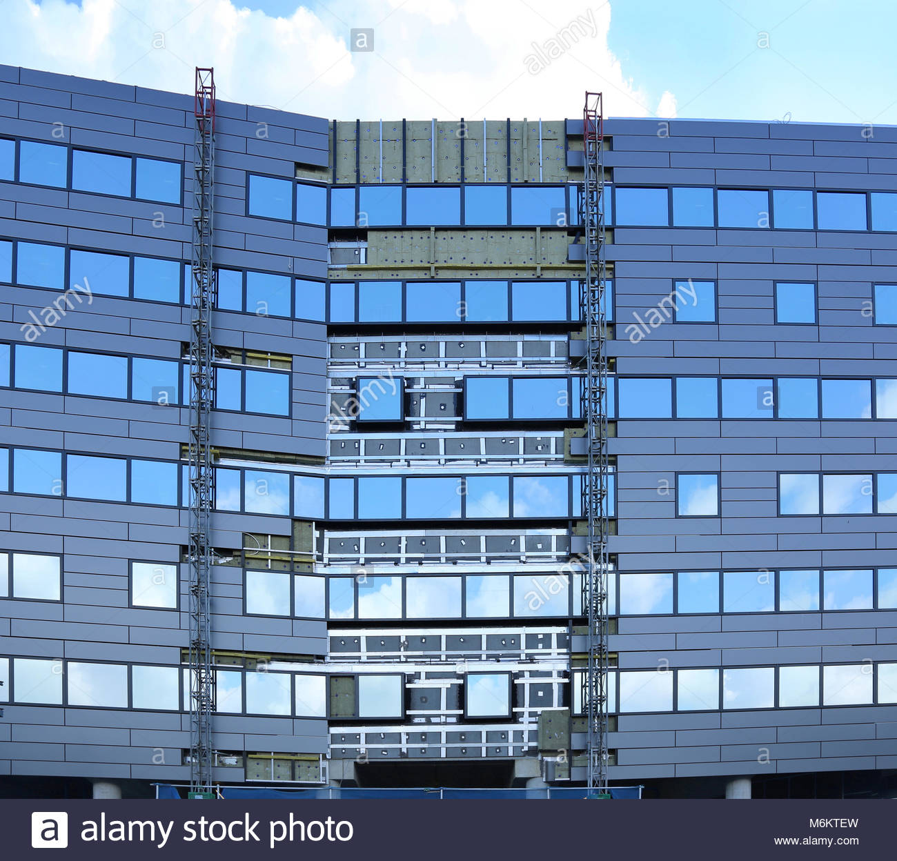 The new Crowne Plaza Hotel under construction at Heathrow Airport London. Shows steel cladding panels placed over - Stock Image