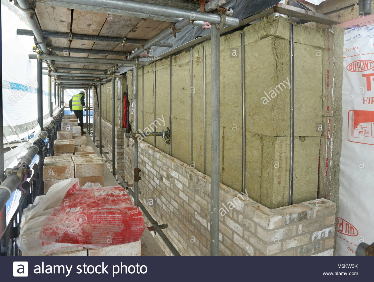 Mineral wool cavity wall insulation installed during the construction of a student accommodation block in London, - Stock Image