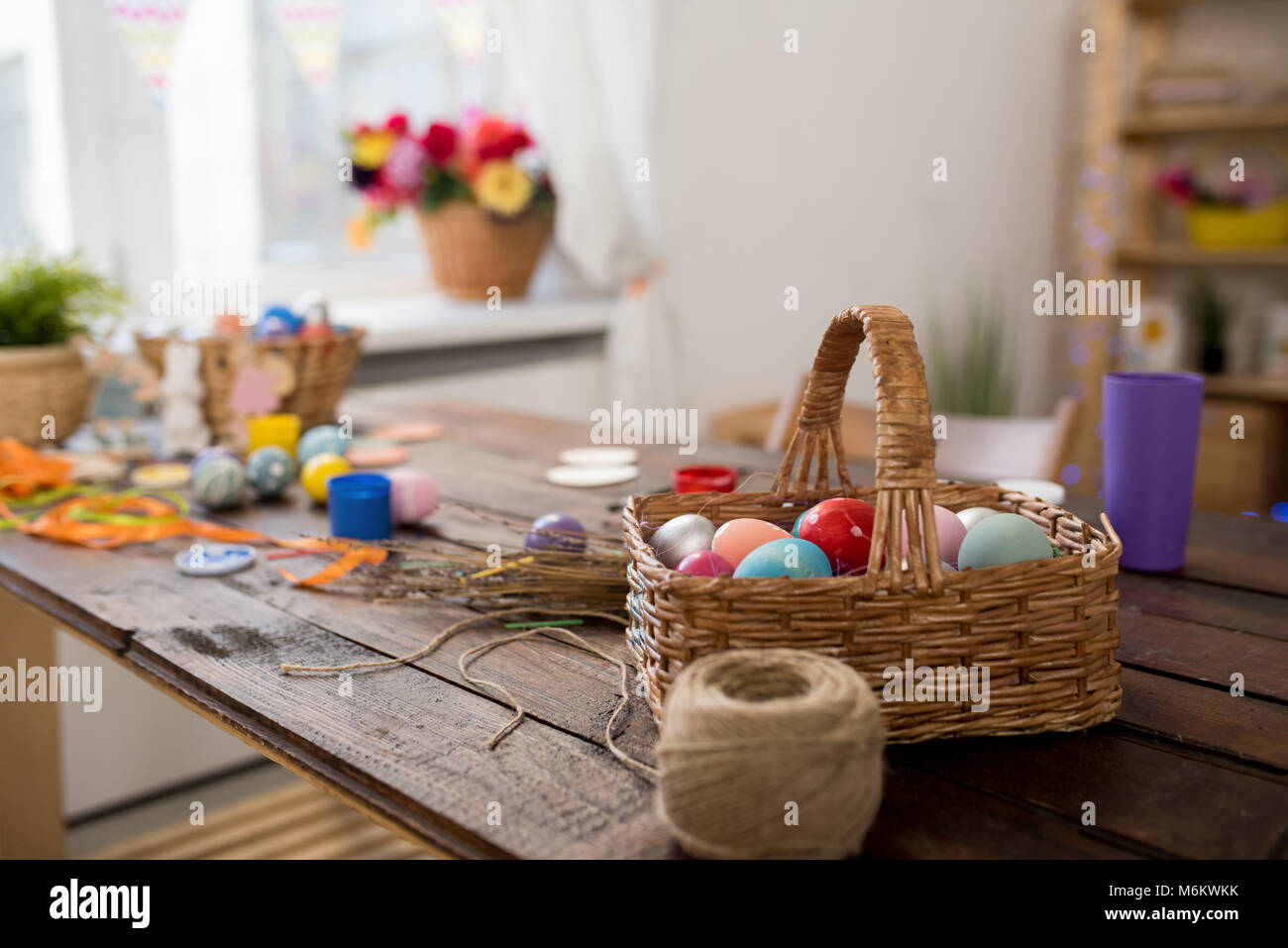 Basket of Easter Eggs on Crafting Table - Stock Image