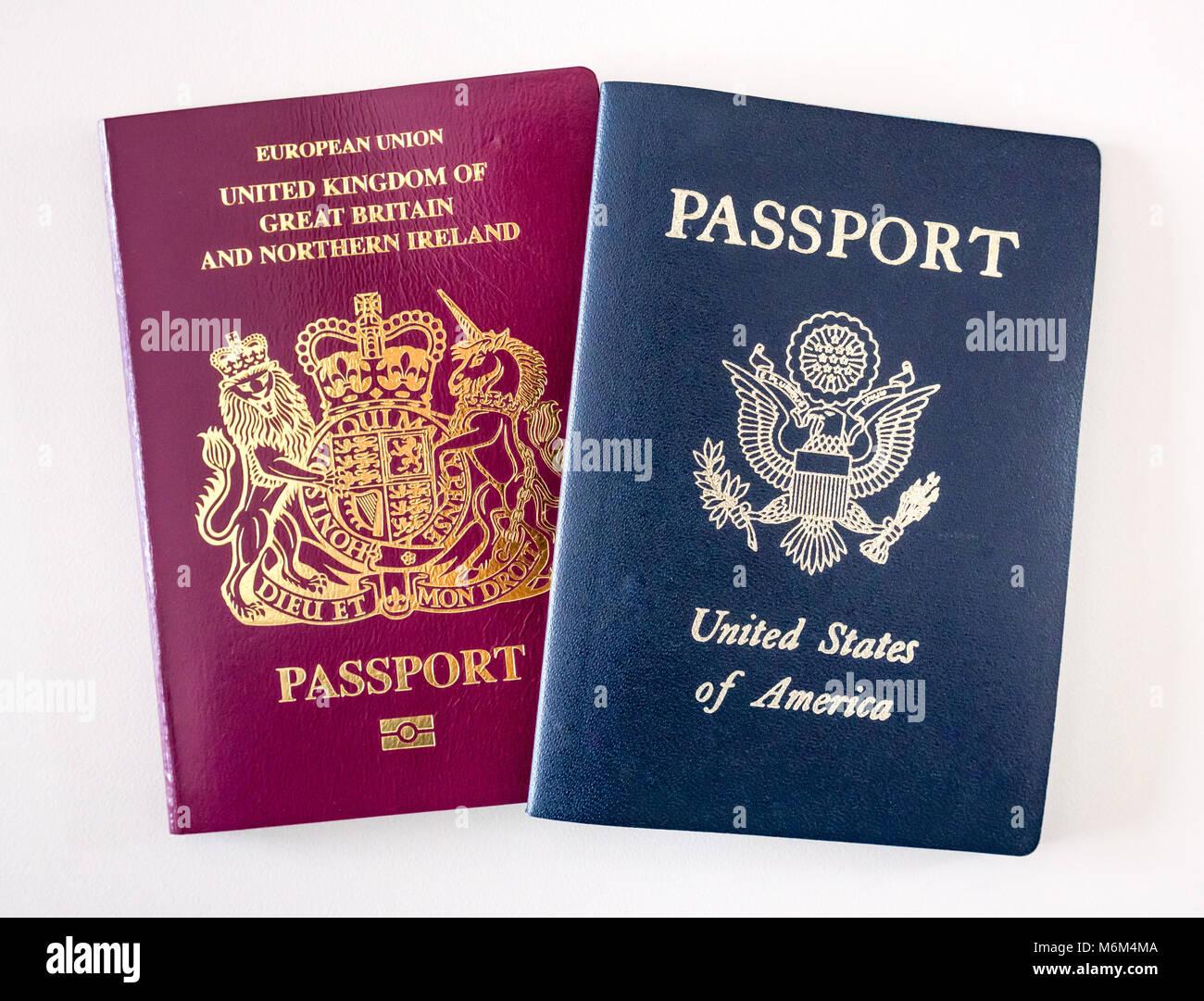 Close up of United Kingdom (UK) and United States (US, USA, America) passports on white background.  Illustrates - Stock Image