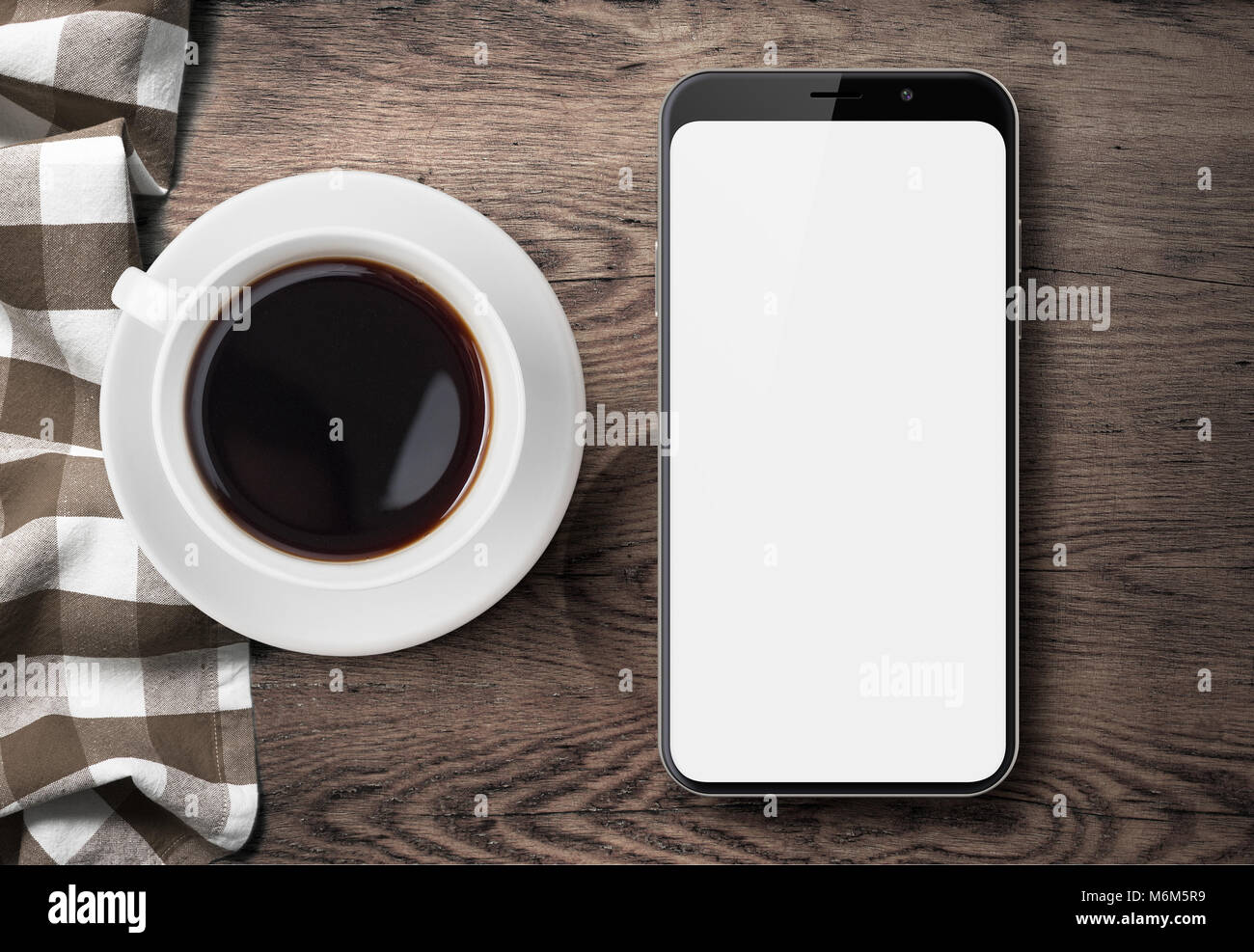 new smartphone top view on old wood table with cloth and coffee Stock Photo