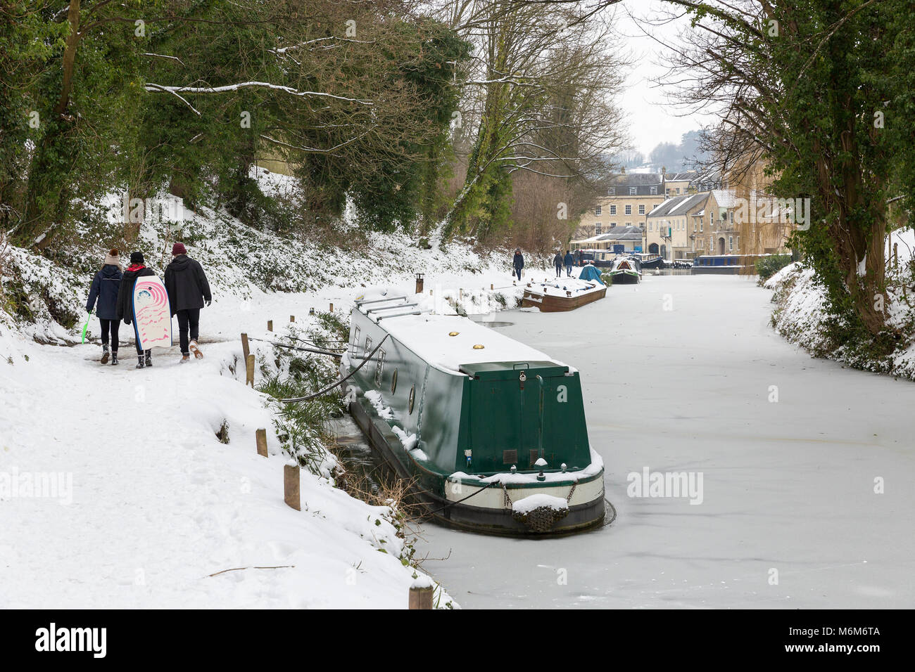 BATH, UK - MARCH 2, 2018 : People walking along the snow covered towpath on the frozen Kennet and Avon Canal near - Stock Image