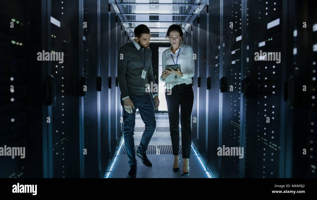 Male And Female Server Technicians Working In Data Center Running Stock Photo Alamy