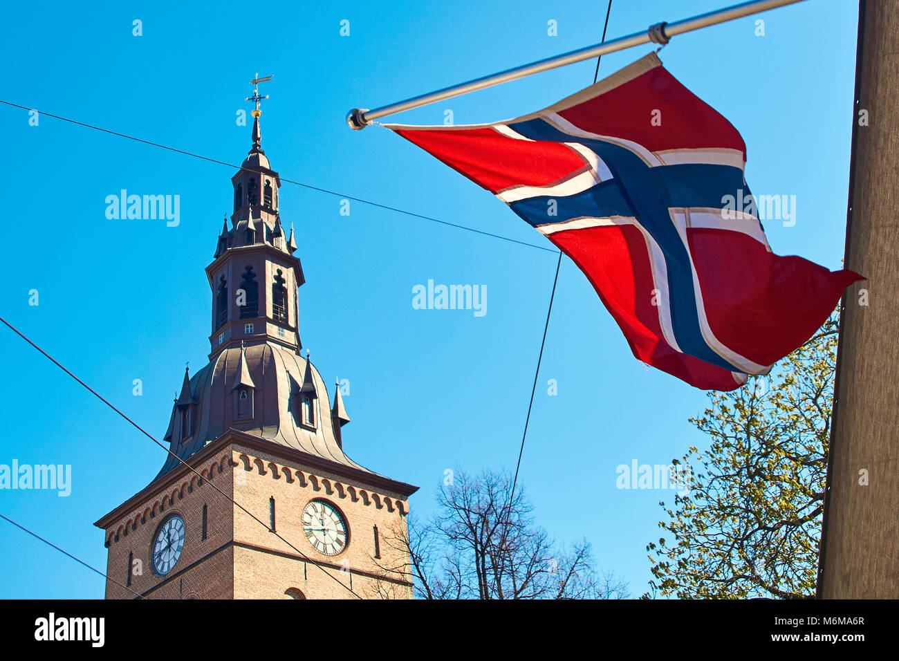 Norwegin flag waving on a sunny spring day in Oslo, Norway Stock Photo